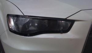 Mitsubishi Outlander 2010-2012 - Защита передних фар, с окантовкой. (EGR)  фото, цена