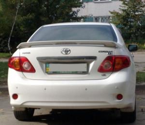 Toyota Corolla 2007-2012 - Спойлер на крышку багажника, под покраску, со стоп сигналом. (TAW) фото, цена