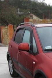 Suzuki SX4 2006-2009 - Дефлекторы окон (ветровики), к-т 4 шт, темные. Cobra Tuning. фото, цена